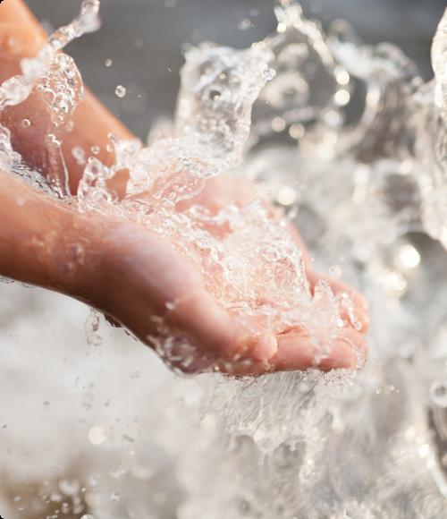 Hands being washed under water